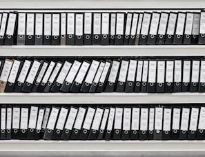 shelf full of data in binders