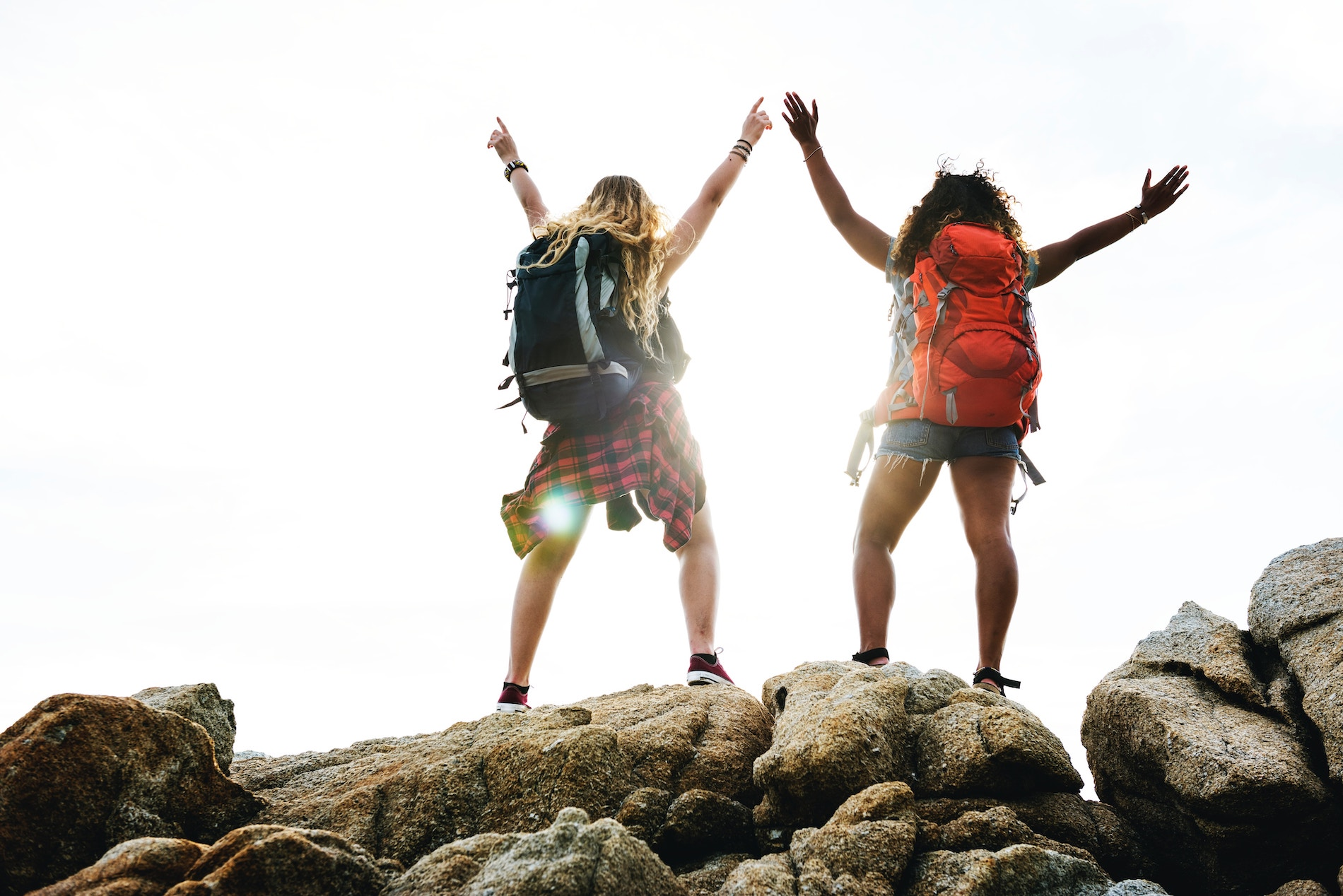two girls enjoying outdoor program for youth empowerment on a mountain top